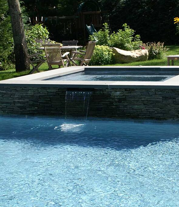 Pool with Jacuzzi. It is a newly installed heated gunite swimming pool and spa with Ecosmarte filtration.