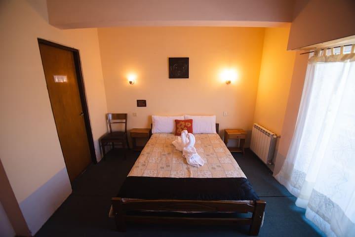 Habitación Matrimonial con vista al Faro