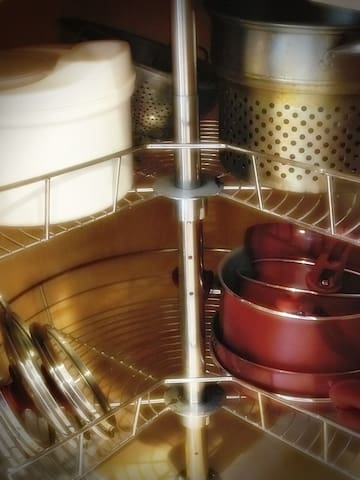 Cupboards are stocked with lots of pots and pans