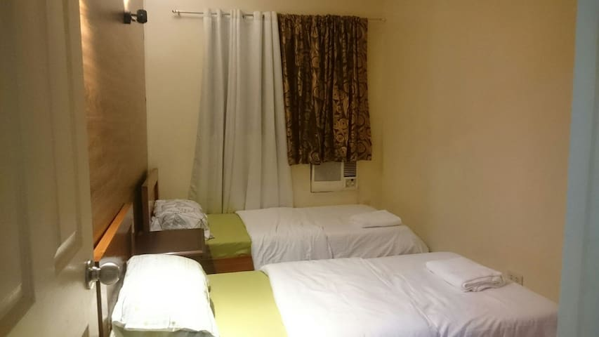 Room #2 (good for 2 persons)     - 2 single beds