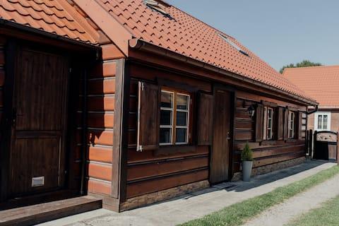 Una casa acogedora de madera con alma en Tykocin.