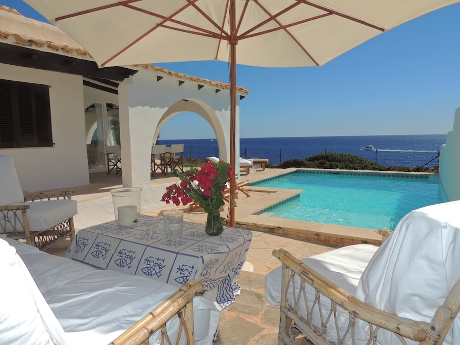 Comfortable sitting area overlooking the pool and the sea