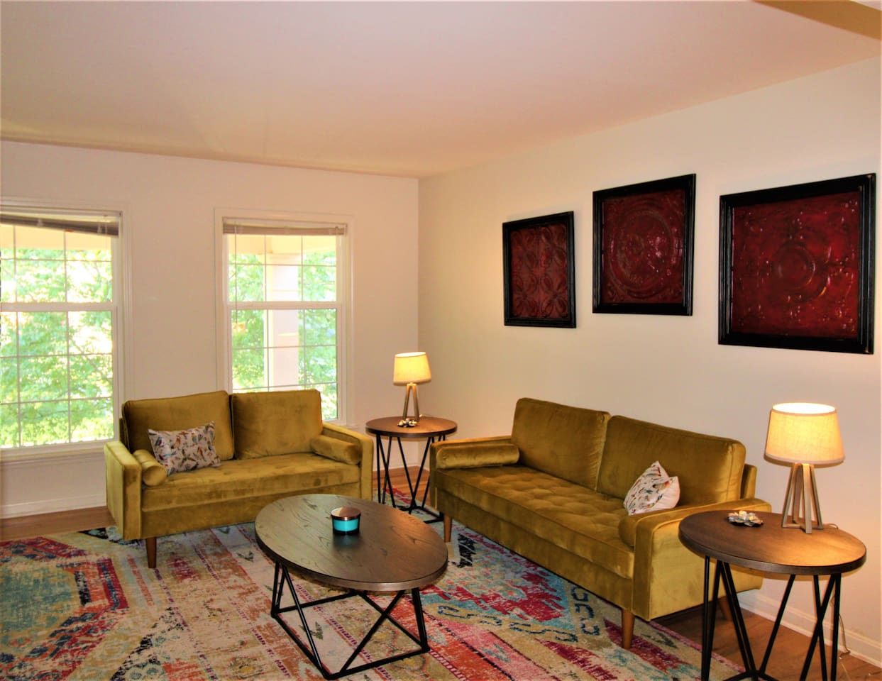 """Comfortable Living Room Setting with 55"""" TV and lots of natural light."""
