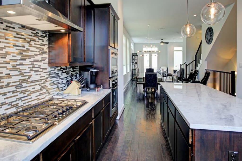Kitchen - Marble Countertops, Wood Floors Throughout, Guest Bathroom on Second Floor.