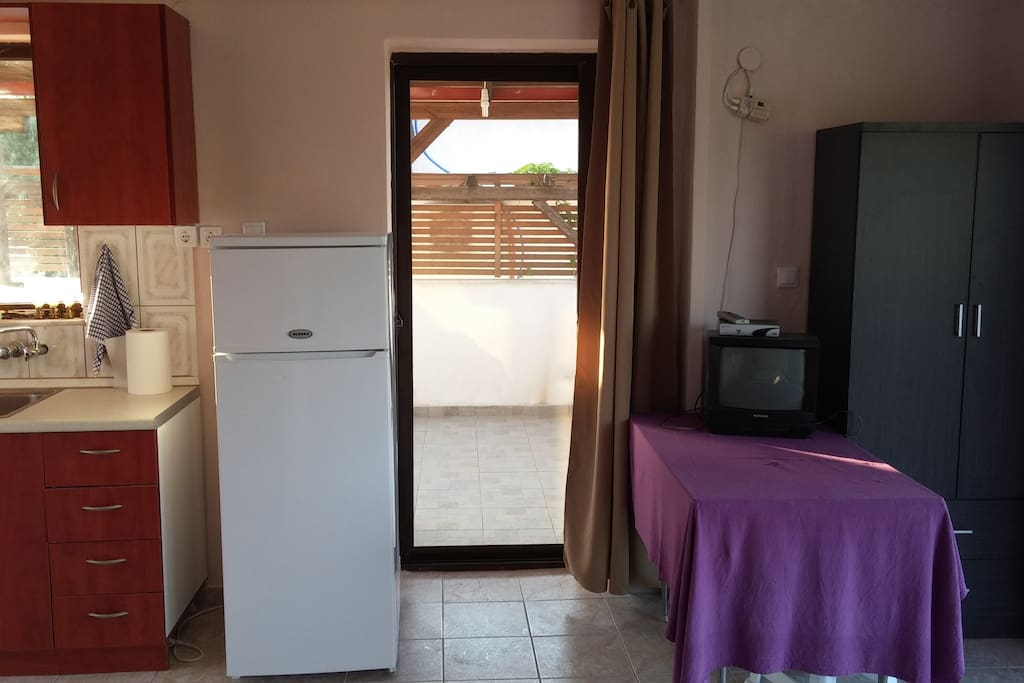 Door to private side balcony by kitchen
