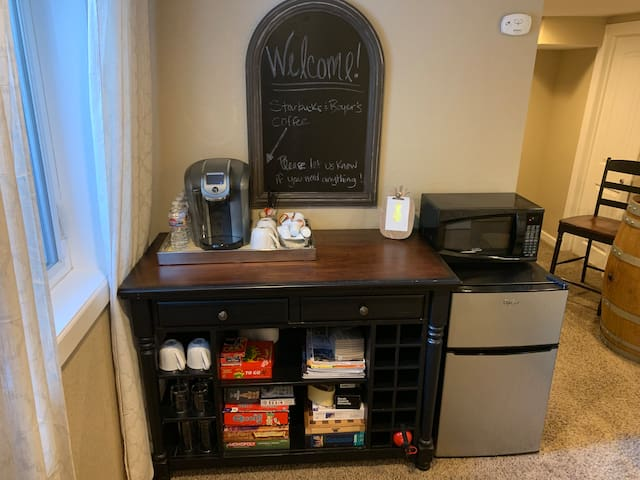 Coffee bar, microwave, mini fridge, and board games