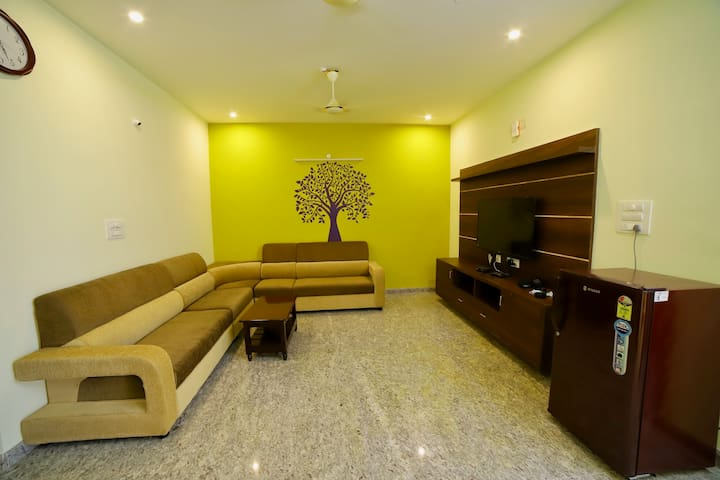 Ultra modern hall with family tree to remind your family values with ❤. The place to all family members to sit and enjoy valuable time with your favorite TV channel or show...