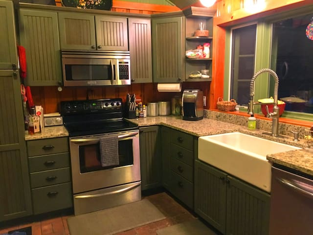 Updated kitchen with granite, stainless steel appliances, farm sink, all cooking supplies and essential condiments.