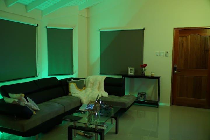 Living room area with hue lighting.