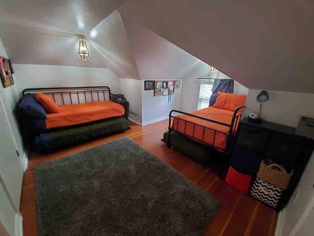 Upstairs bedroom. 4 twin beds