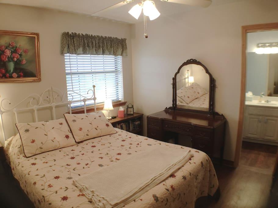 Queen Bed, door to full bathroom