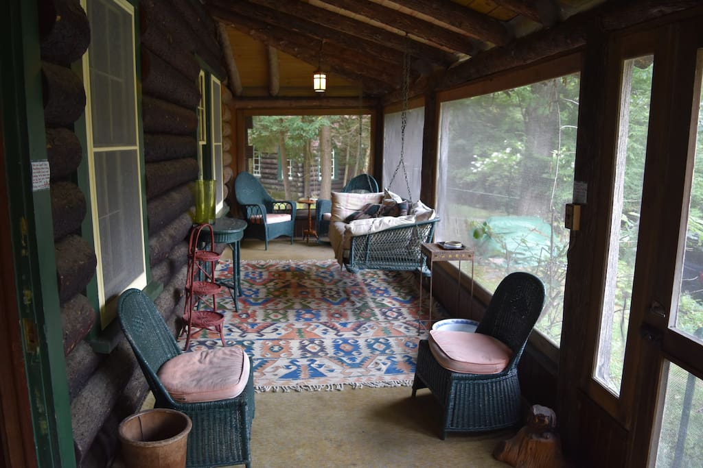 Tranquil front porch/sunroom area with swinging chair