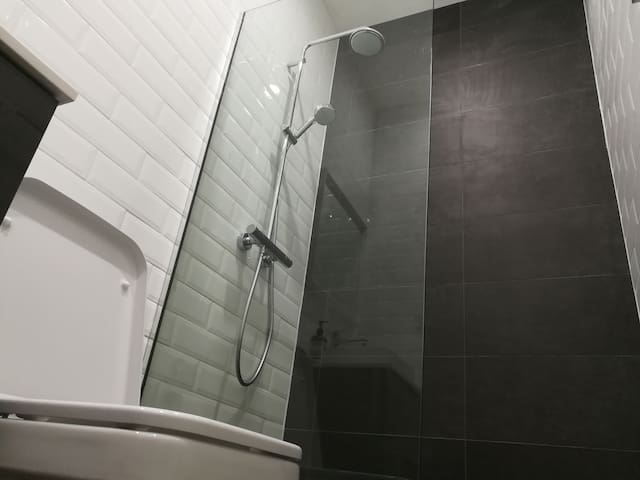 Shower, toilet, and basin in each bathroom