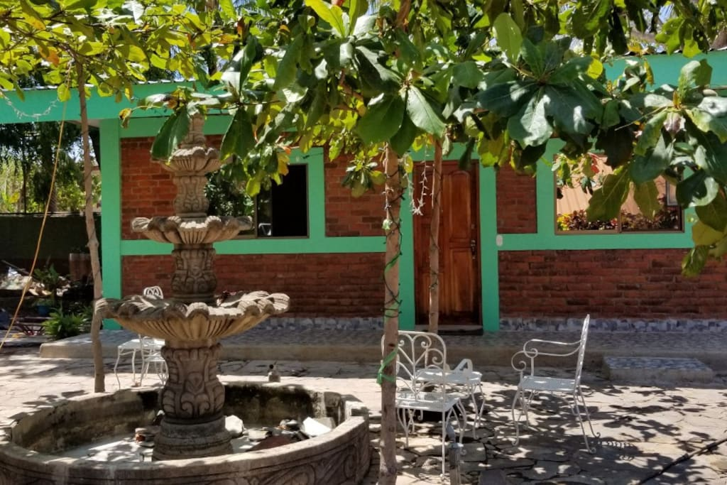 Front view of cottage - 5 tiered fountain & almond trees + sitting areas are very pleasant - great place to hang out!