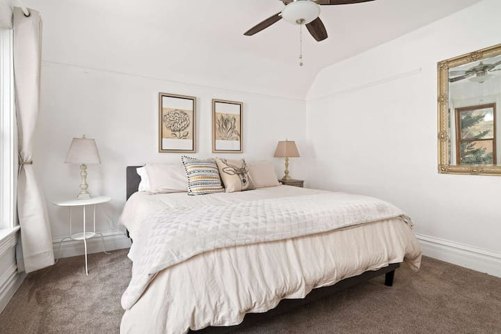 Luxury linens, clean and thoughtful decor, and spacious layout make this master suite a perfect respite.