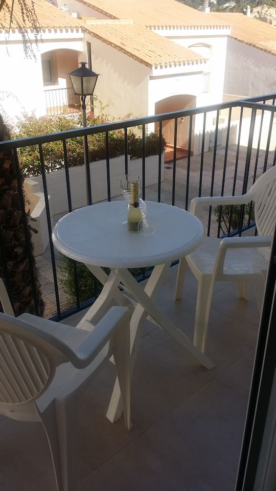 Enjoy a drink on the front balcony