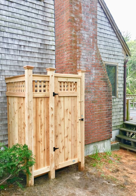 Custom Cape Cod outdoor shower with hot water
