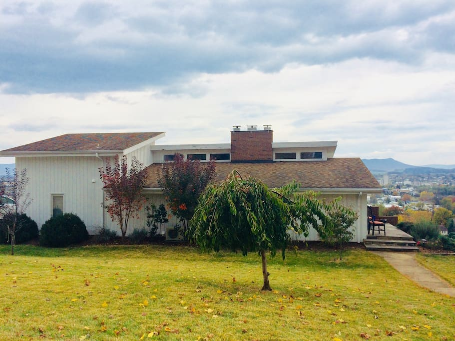 Our home is situated on a ridge overlooking the city looking east.  The view is spectacular and the neighborhood is quiet.  We are a five-minute drive to downtown, 10 min to JMU, less than 5 min to EMU.