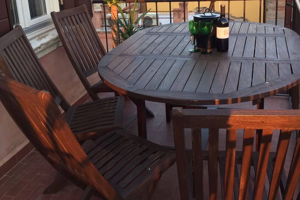Dinning table on the balcony makes romantic atmosphere