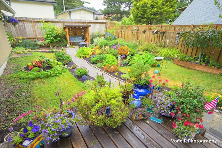Latest photo of our backyard with lots of new flowers and growth- great place to hang out and relax!
