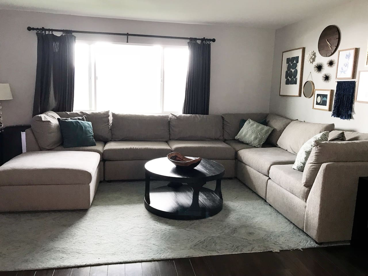 Spacious living room. Portable air conditioner in room.