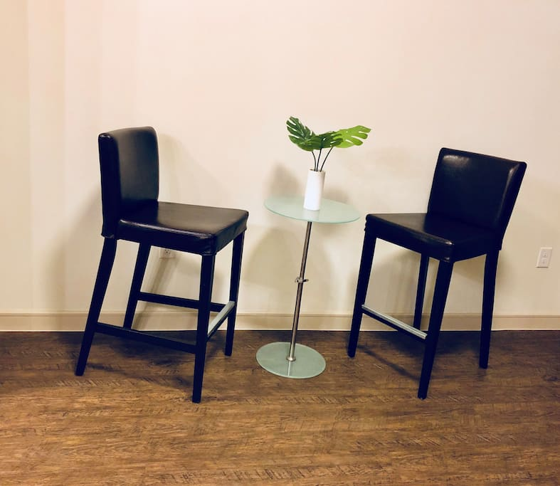 Adjustable bistro table (can be lowered for lap top friendly space ) with optional seating