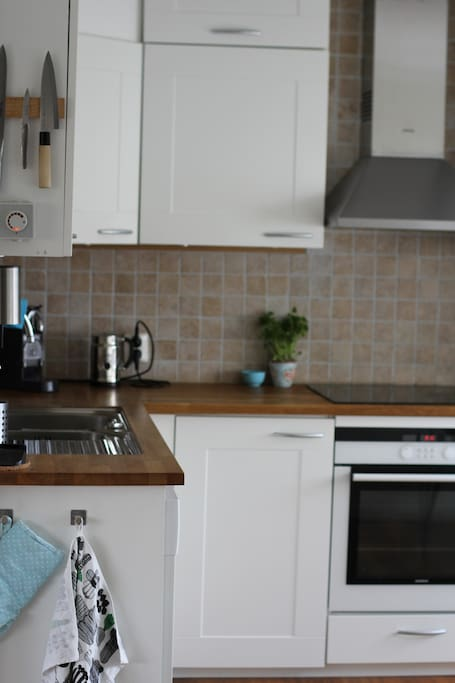 Kitchen, dish washer, owen, stove, fridge, freezer, coffey machine, soda streamer. Table with space for four people.