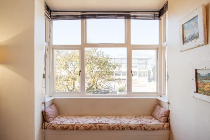 Bay window for reading and watching the mountain.