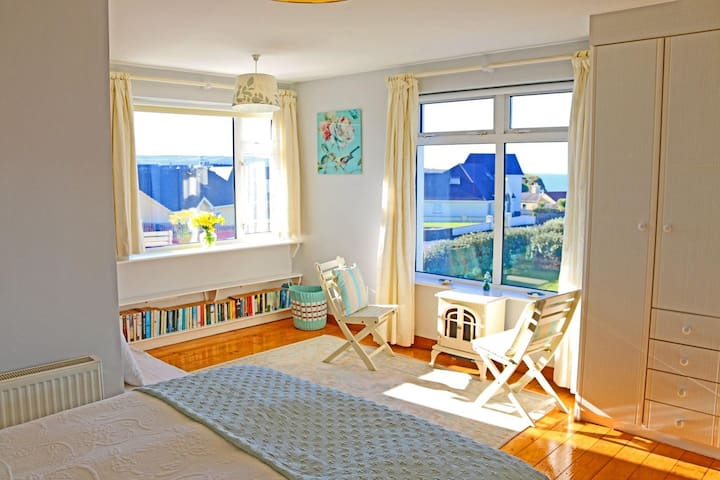 King bedded en-suite room with a sea view.