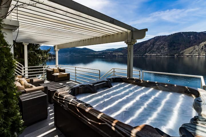 Modern and stunning lakefront home! Views, private hot tub, deck, and dock!