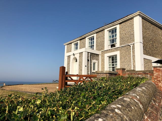 Entrance with sea views from the village into private gated drive.