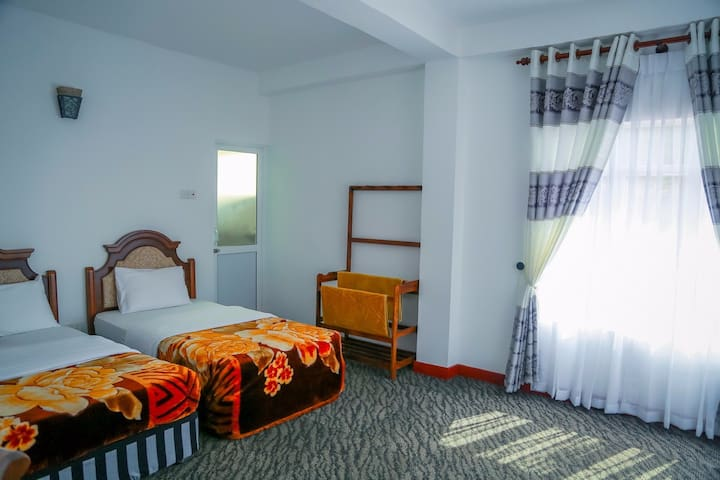 Deluxe triple room with mountain view