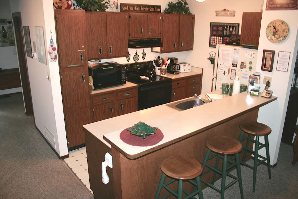 Kitchen and counter with bar seating
