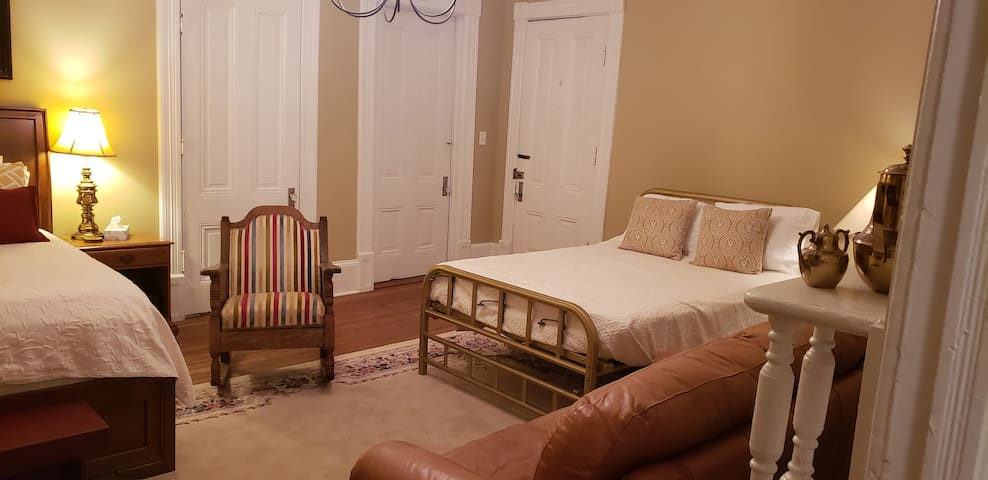 An original 1929 Murphey bed that has been fully restored and loaded with a comfortable mattress.  The Murphey bed can be raised to get it out of the way during the daytime.