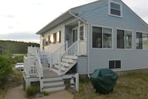 Cottage. Enjoy morning coffee on side deck with partial ocean views and listen to the waves