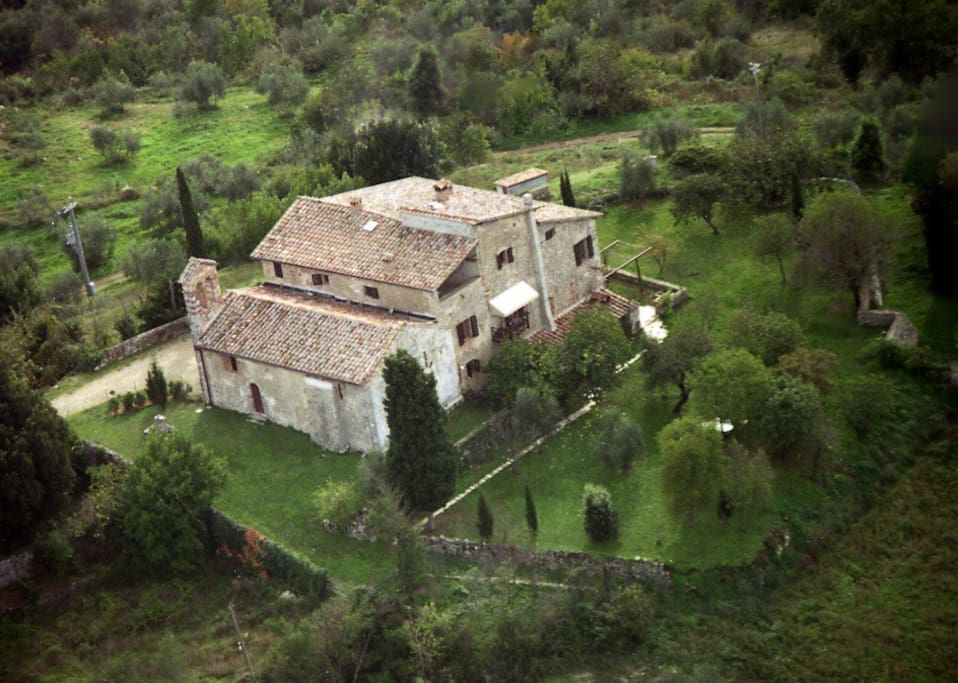 Air view: the rectory house with the church and garden
