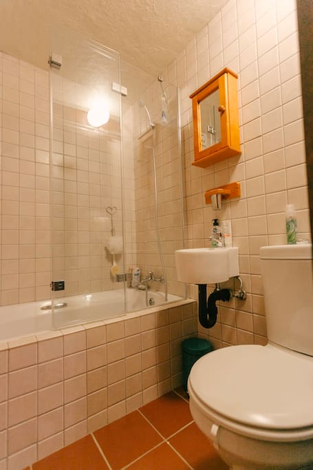 Take a relaxing Bath, or Shower in the quaint & private Bathroom.