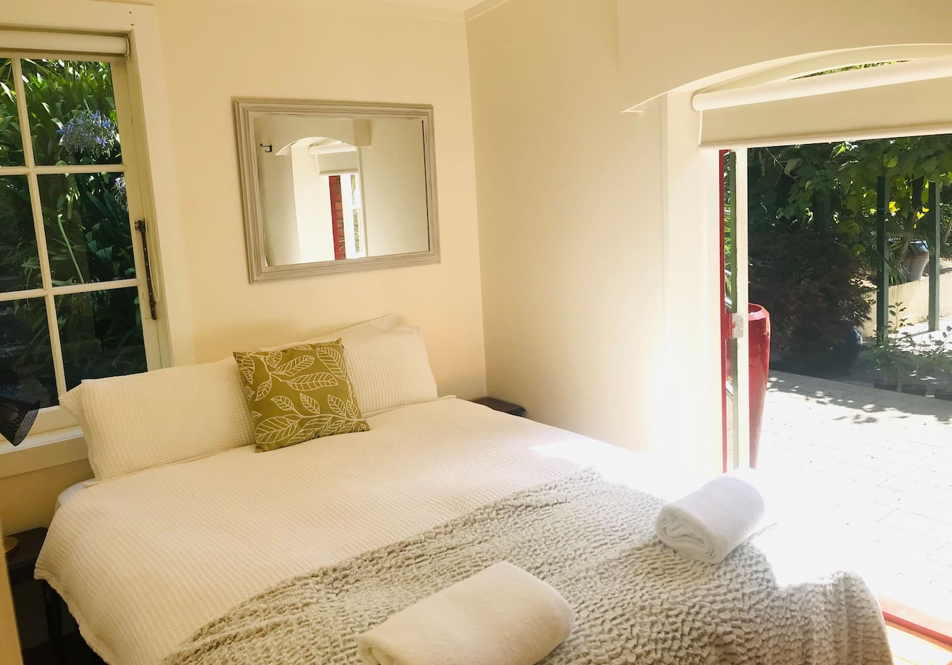 'Little Italy' queen bedroom with Italian doors out onto patio. Wake up to birdsong in a very serene and peaceful setting.