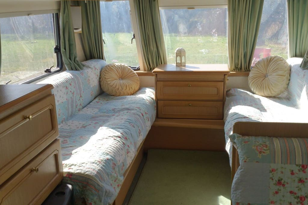 Daisy Caravan - large double bed folds back to 2 sofas.