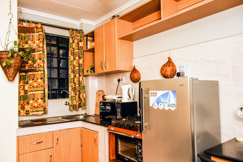 Fully furnished kitchen area with artistic touches