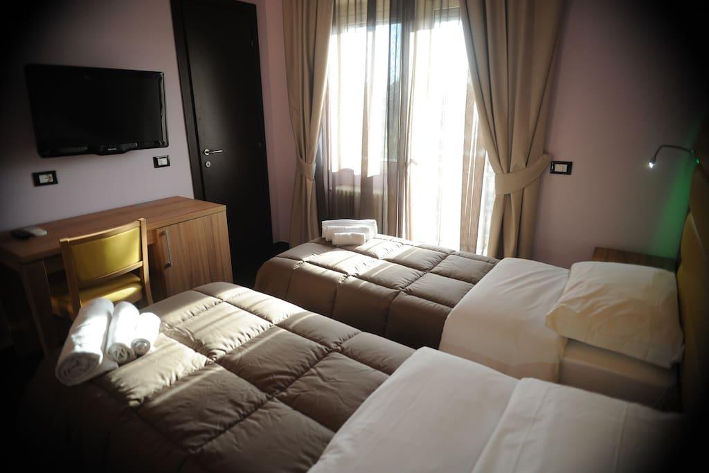 camera con letti singoli con balcone