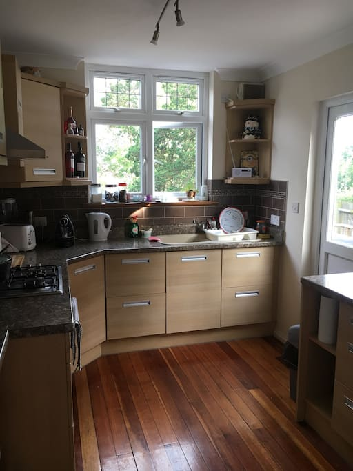 Kitchen with toaster, electric oven and microwave.