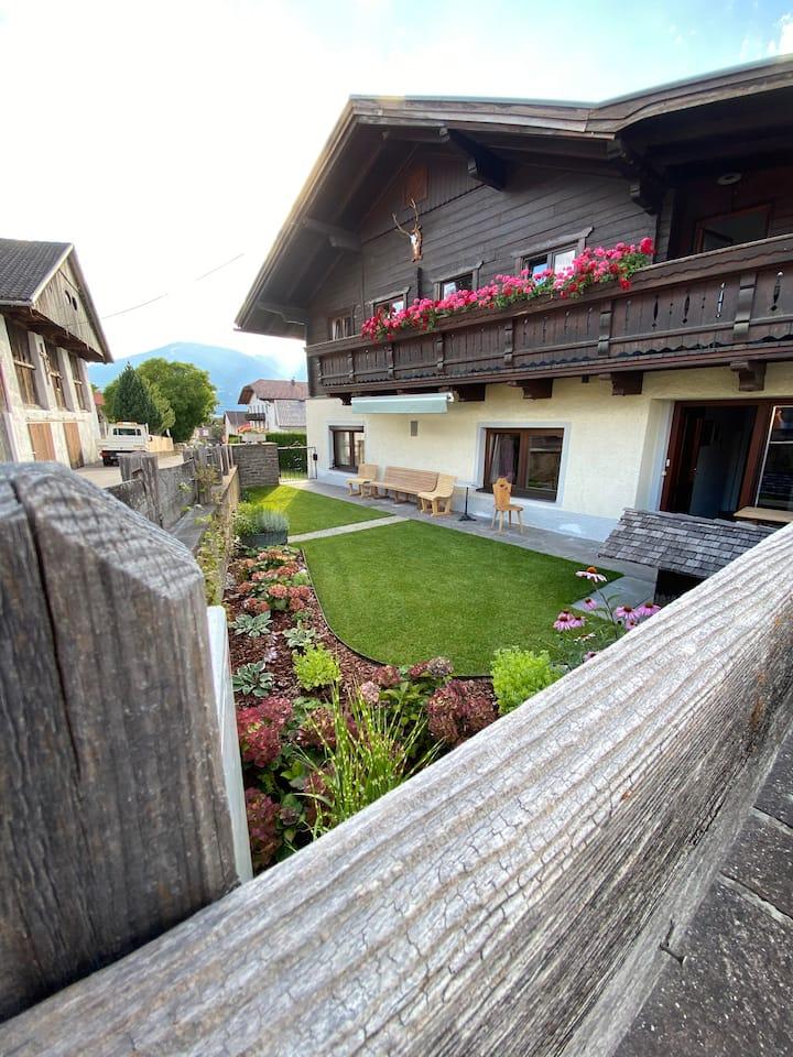 Ferienwohnung Dolomiten - Gartenblick