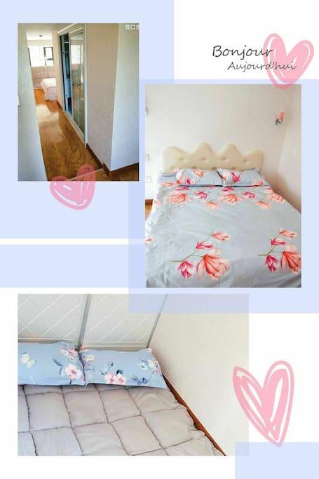 两间非封闭式卧室,一张床,一张榻榻米