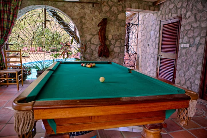 The pool table creates another test of skill for guests.