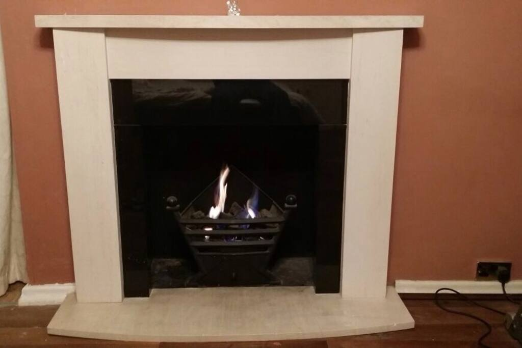 Feature Gas fire with Surround in the bedroom