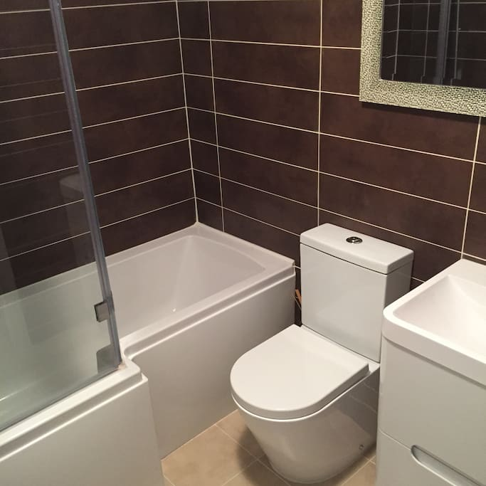 Newly fitted bathroom, large L shape shower bath & heated towel rail.