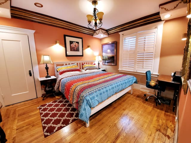 Spacious bedroom with king-size bed and writing desk
