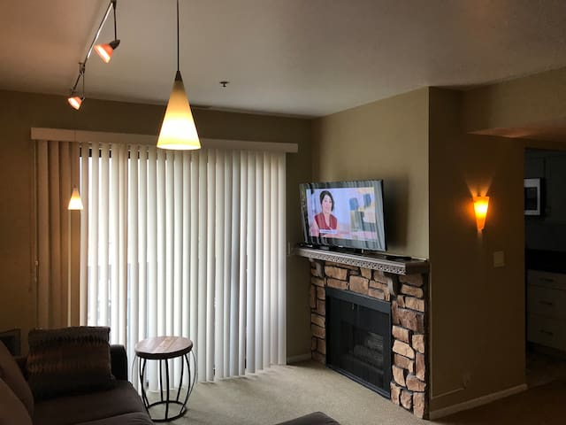 gas operated fireplace, smart tv with cable and apps