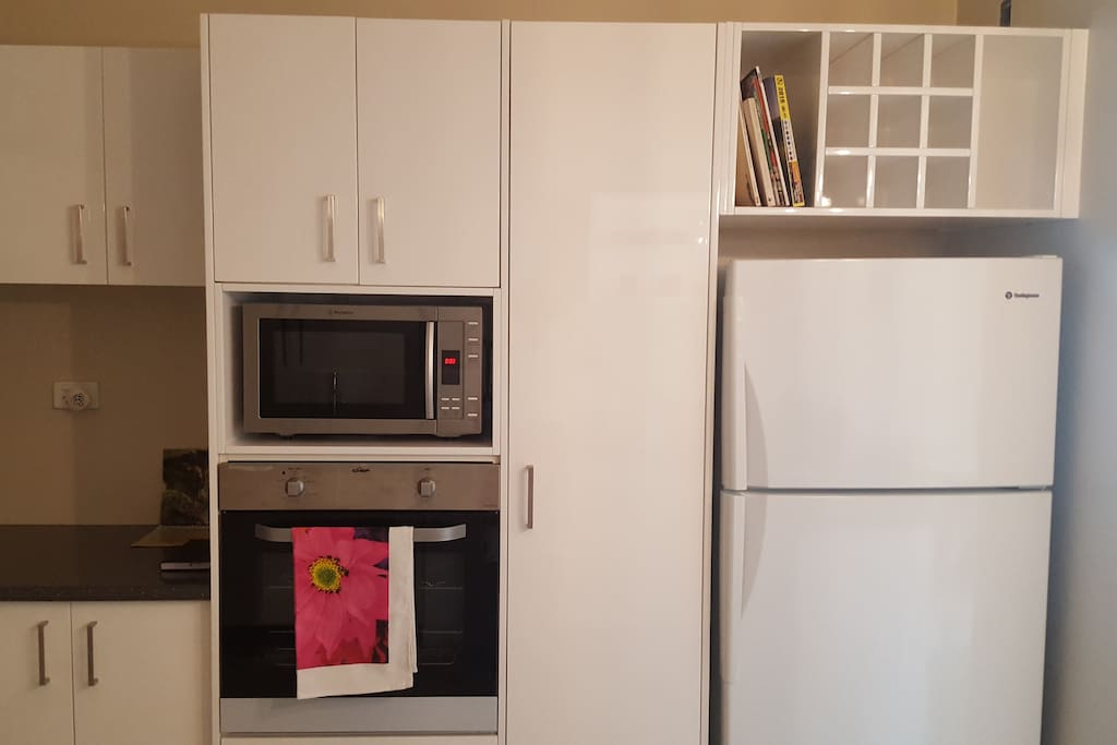 Kitchen- fridge, oven and microwave. New appliances.